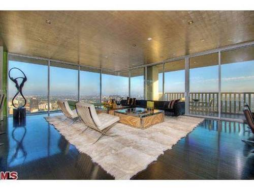 """The condo previously owned by John reported still includes furniture and """"knickknacks"""" that belonged to the singer."""