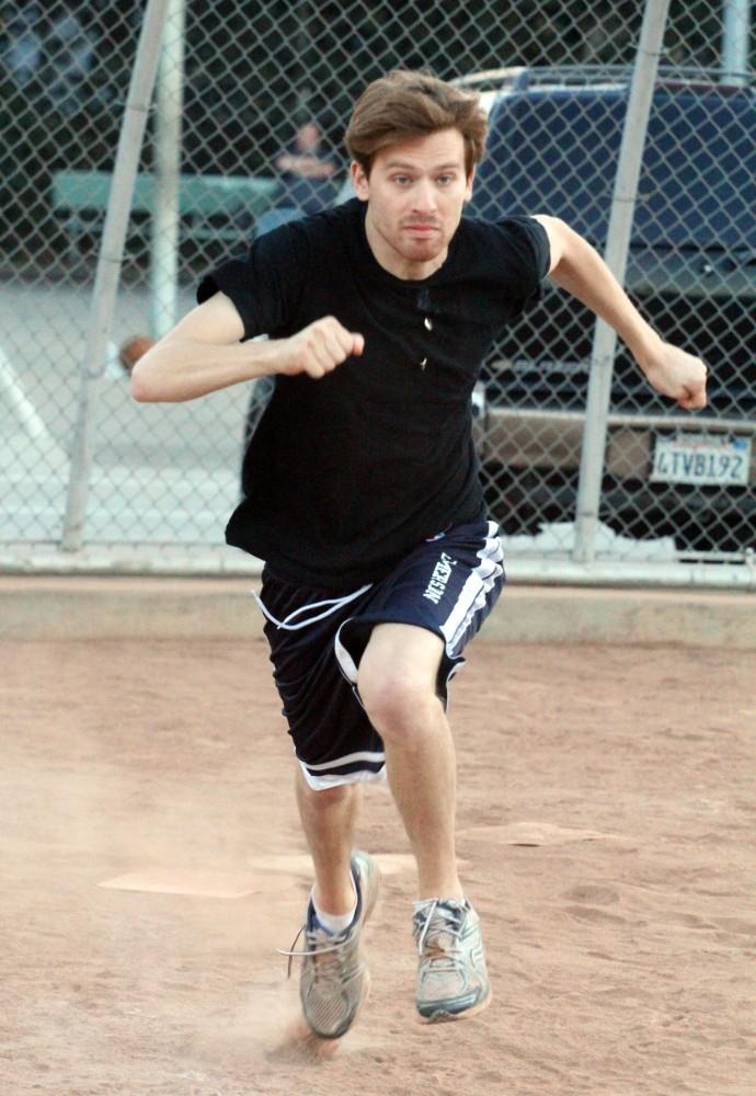 New Kicks' Claude Zeins hustles to first base. Three kicks later, he scores the winning run.