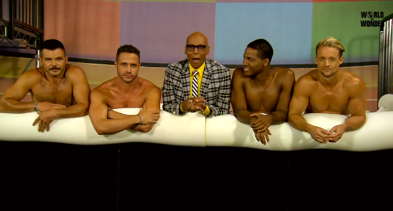 """RuPaul with crew members saying """"bye"""" to the audience."""