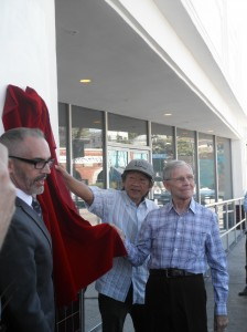 A plaque acknowledging the Black Cat's role in LGBT history was unveiled Tuesday  by LA Councilmember Mitch O'Farrell, left; Wes Joe of the Friends of the Black Cat, center, and Alexei Romanoff, right, who was present at the 1967 protest.