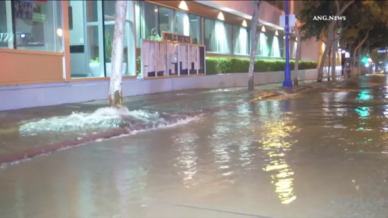 Flooding in front of West Hollywood City Hall on Santa Monica Boulevard (Photo by Jim Garrecht / ANG News)