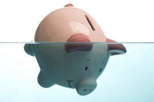debt-pig-drowning